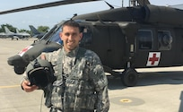 Capt. Dan Davis, Charlie Company, 3rd Battalion, 126th Aviation Regiment (Air Ambulance), Vermont Army National Guard, poses for a photograph.