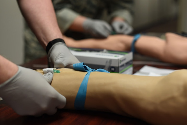 An Airman from the 87th Medical Group places an IV in a multi-venous IV training arm during an IV contest at Joint Base McGuire-Dix-Lakehurst, N.J., May 8, 2018. The IV contest was part of a series of events during nurse's week to challenge the skills of the medical staff and show appreciation for nurses. (U.S. Air Force photo by Airman Ariel Owings)