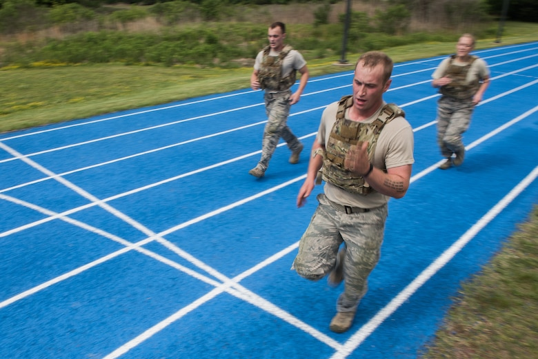 U.S. Air Force Airmen from the 633rd Security Forces Squadron, run during the National Police Week Defenders' Challenge at Joint Base Langley-Eustis, Virginia, May 16, 2018.
