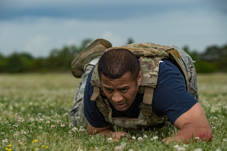 U.S. Air Force Senior Master Sgt. Dzajic Martinez, 633rd Security Forces Squadron operations superintendent, low crawls during the National Police Week Defenders' Challenge at Joint Base Langley-Eustis, Virginia, May 16, 2018.