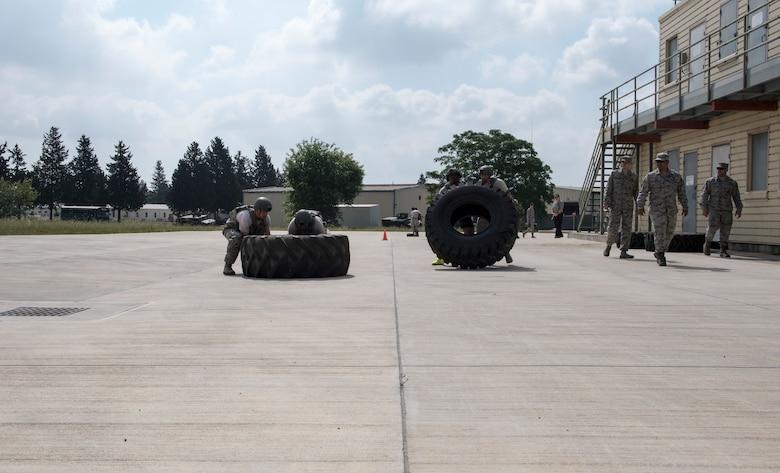 Airmen flip giant tires during event