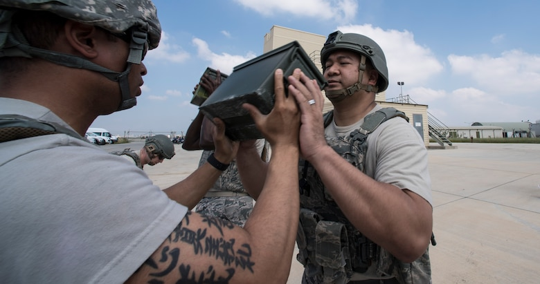 Airmen pass ammunition can back and forth during event