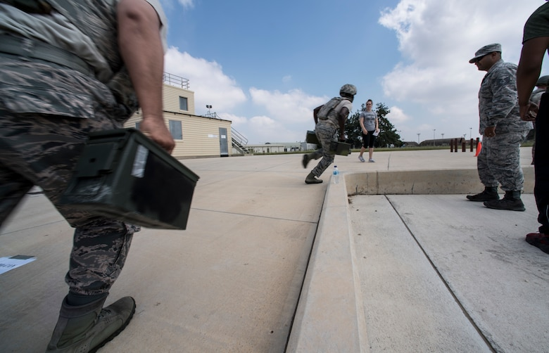 Airmen running with ammunition cans during event