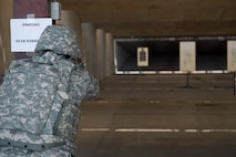 Airman shoots pistol during competition.