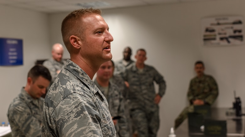 U.S. Air Force Capt. Johnathan Read thanks everyone for participating in the M9 pistol firing competition.