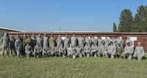 Group poses for photo after the M9 pistol firing competition.