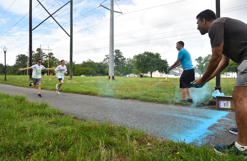Kids from the Joint Base Charleston Youth Center prepare to be hit with colored chalk during a color run May 18, 2018, at JB Charleston, S.C.