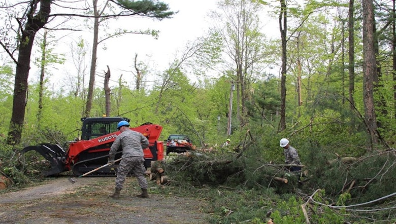 Airmen from the 103rd Civil Engineering Squadron begin clearing Downs Road May 18, 2018 in Bethany, Conn. The Connecticut National Guard was activated to assist local and state agencies from the devastation cause by the storm May 15, 2018. (U.S. Air National Guard photo by 1st Lt. Jen Pierce/released)