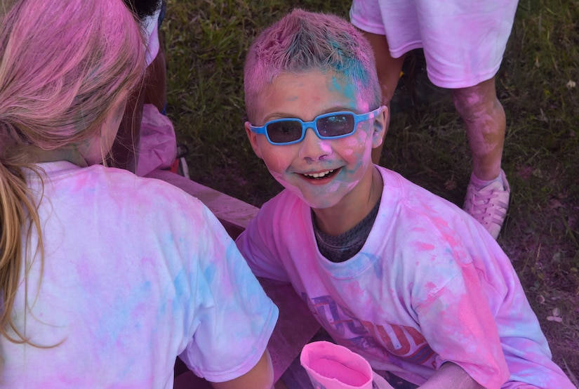 A child from the Joint Base Charleston Youth Center plays with leftover chalk at the Annual Armed Forces Kids Color Run, May 18, 2018, at Joint Base Charleston.