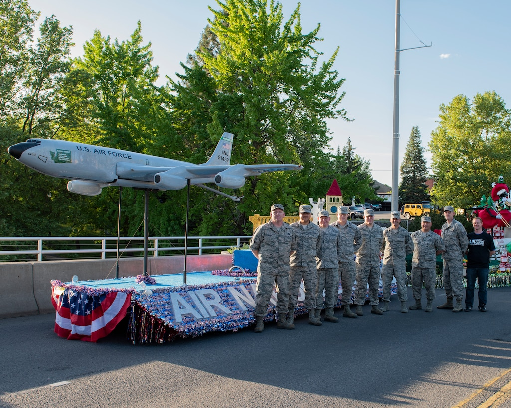Guardsmen from the 141st Air Refueling Wing pose in front of the Air National Guard parade float prior to the start of the 80th Annual Lilac Festival Armed Forces Torchlight Parade May 19, 2018 in Spokane, Wash. The float is built, maintained and operated by Guardsmen volunteering their time to participate in the parade annually. (U.S. Air National Guard photo by Staff Sgt. Rose M. Lust)