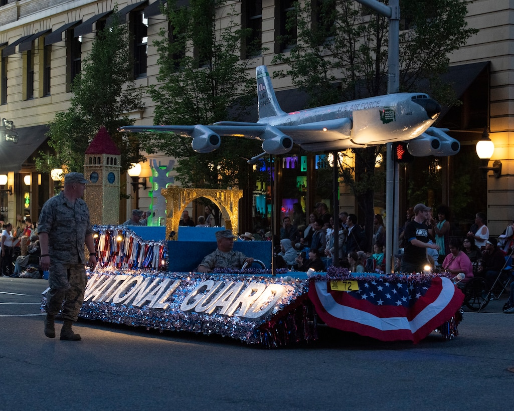 Guardsmen from the 141st Air Refueling Wing walk alongside the Air National Guard parade float during the 80th Annual Lilac Festival Armed Forces Torchlight Parade May 19, 2018 in Spokane, Wash. Over 150,000 spectators make their way into the streets of downtown Spokane to watch the parade annually. The parade is a culmination of the weeklong Lilac Festival, which focuses on honoring military, empowering youth, and showcasing the region. (U.S. Air National Guard photo by Staff Sgt. Rose M. Lust)