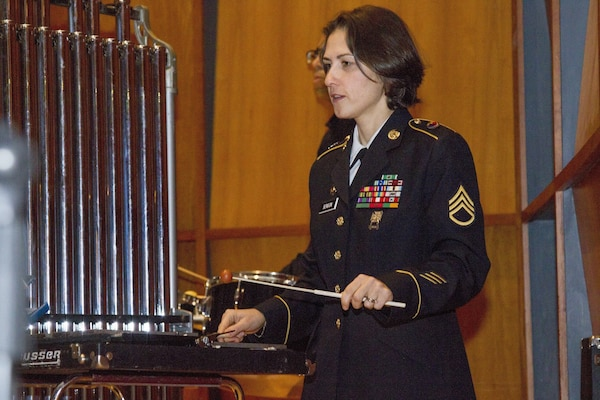 U.S. Army Staff Sgt. Yulia Benson, bandsman, 40th Army Band, Vermont Army National Guard plays during a concert.