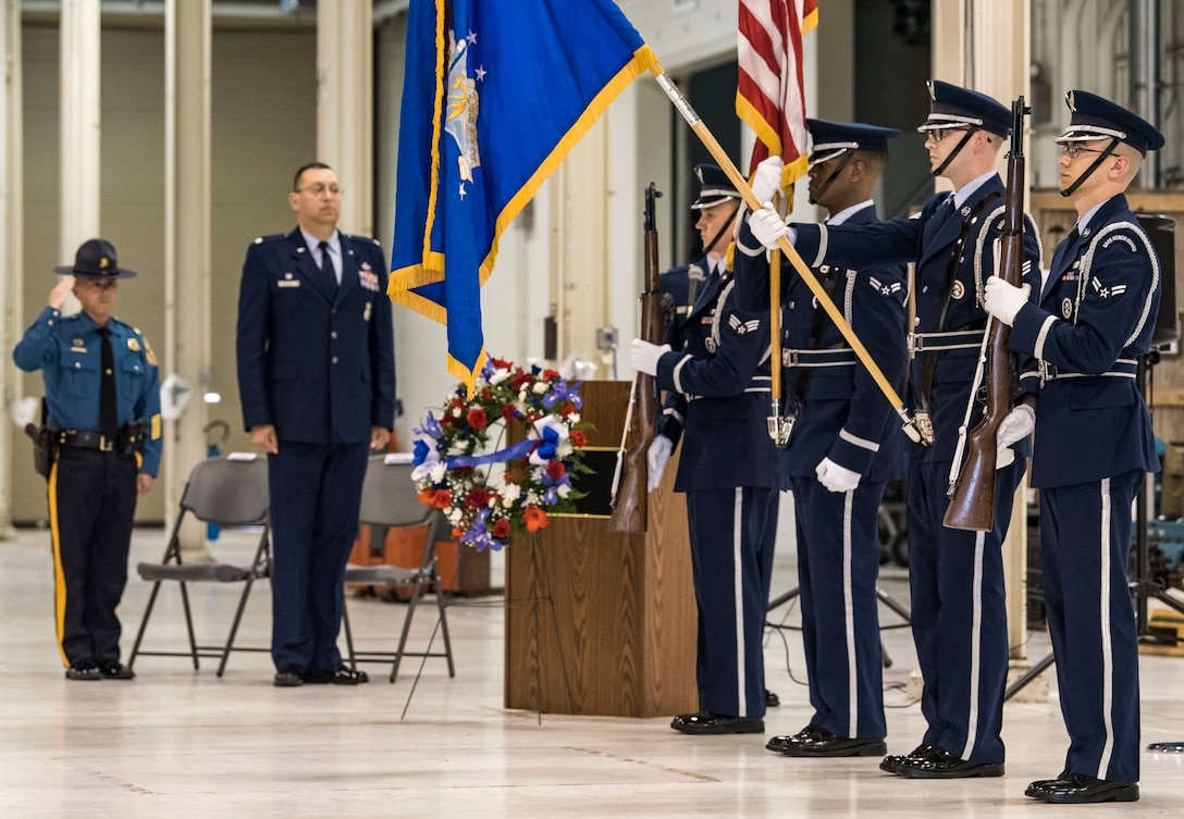 A 436th Airlift Wing Base Honor Guard detail posts the colors at the start of the National Police Week Remembrance Ceremony May 18, 2018, at Dover Air Force Base, Del. Maj. Sean Moriarty (left), Delaware State Police operations officer for Kent and Sussex Counties in Delaware, was the guest speaker for the ceremony. Lt. Col. Michael Morales (center left), 436th Security Forces Squadron commander, hosted the event honoring 14 fallen Air Force security forces members from recent conflicts since 2005. (U.S. Air Force photo by Roland Balik)