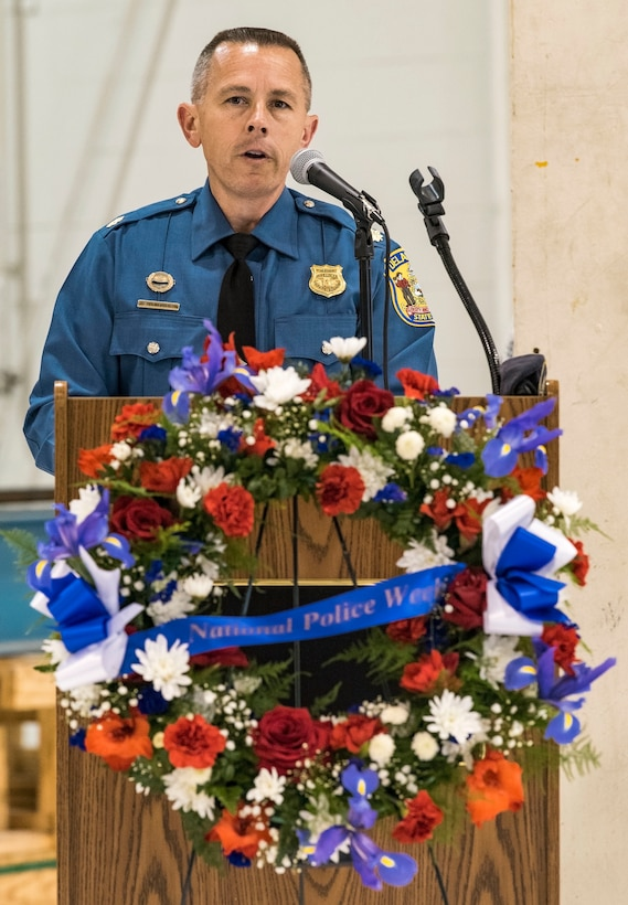 Maj. Sean Moriarty, Delaware State Police operations officer for Delaware's Kent and Sussex Counties, speaks to attendees at the National Police Week Remembrance Ceremony May 18, 2018, at Dover Air Force Base, Del. The 436th Security Forces Squadron hosted numerous events in recognition of National Police Week. (U.S. Air Force photo by Roland Balik)