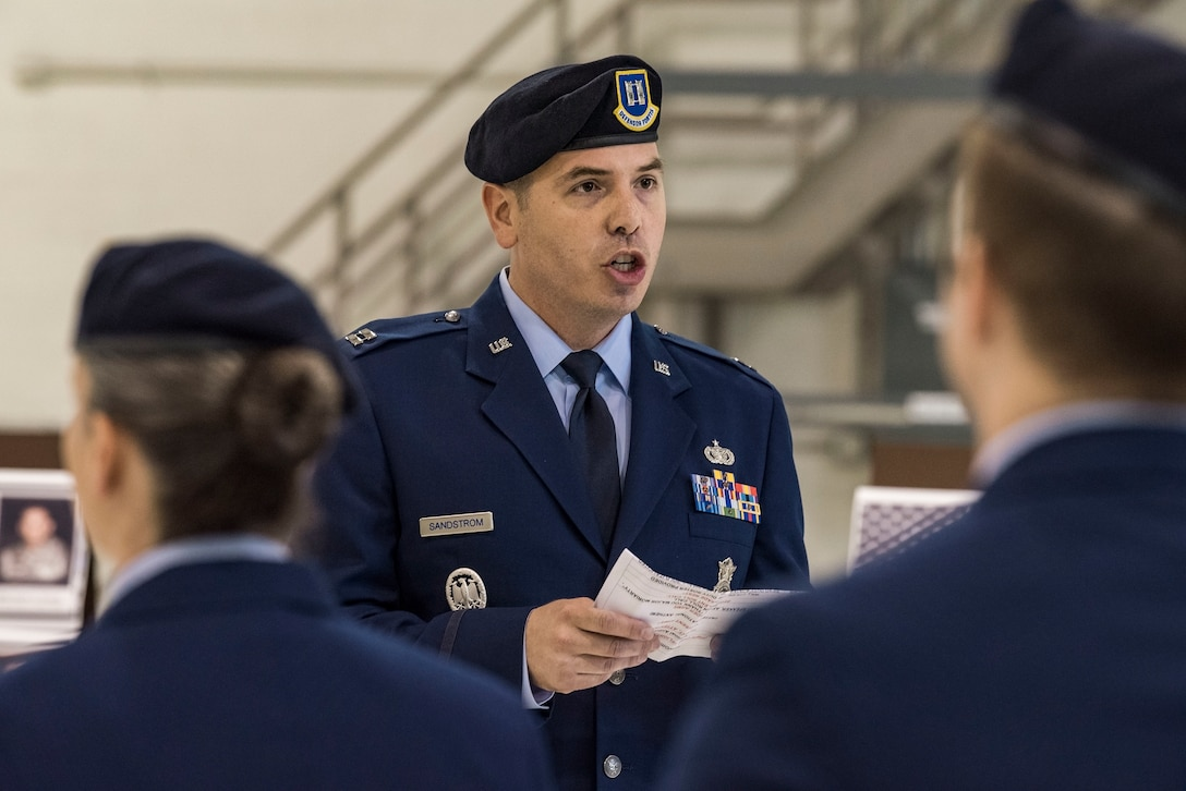 Capt. Jesse Sandstrom, 436th Security Forces Squadron operations officer, reads a duty roster in remembrance of 14 fallen Air Force security forces members May 18, 2018, during the National Police Week Remembrance Ceremony at Dover Air Force Base, Del. Sandstrom called out each name three times in succession prior to the emcee reading a brief narration of their untimely death in the line of duty. (U.S. Air Force photo by Roland Balik)