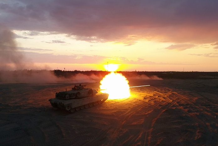 Marines with Bravo Company, 4th Tank Battalion, fire a M1A1 Abrams tank during a low-light live-fire exercise as part of Exercise Arrow 18 in Pohjankangas Training Area near Kankaanpaa, Finland, May 16, 2018. Exercise Arrow is an annual Finnish multi-national exercise with the purpose of training with mechanized infantry, artillery, and mortar field training skills in a live-fire exercise. This is the first year the Marine Corps is participating in this exercise and the first time the M1A1 Abrams tanks have been in Finland. (U.S. Marine Corps photo by Staff Sgt. Marcin Platek/Released)