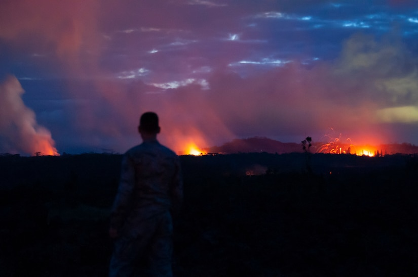 A member of the Hawaii Air National Guard observes three lava fissures at the Leilani Estates and Lanipuna Gardens subdivisions in Pahoa, Hawaii.