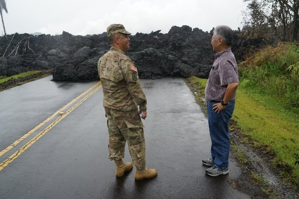 Brig. Gen. Kenneth Hara, Joint Task Force 5-0 commander, and Hawaii Gov. David Ige examine an area in Leilani Estates where lava over ran the road, May 08, 2018, Pahoa Hawaii.