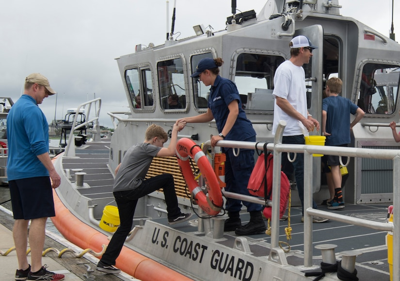 Attendees tour a U.S. Coast Guard cutter during an open house at Coast Guard Sector Charleston, S.C., May 19, 2018, to observe the kickoff for National Safe Boating Week.