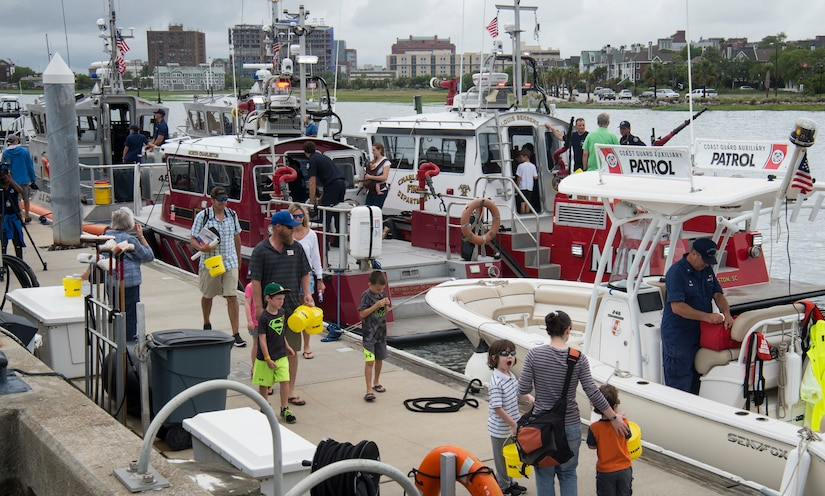 Attendees tour U.S. Coast Guard boats, cutters and vessels during an open house at Coast Guard Sector Charleston, S.C., May 19, 2018.