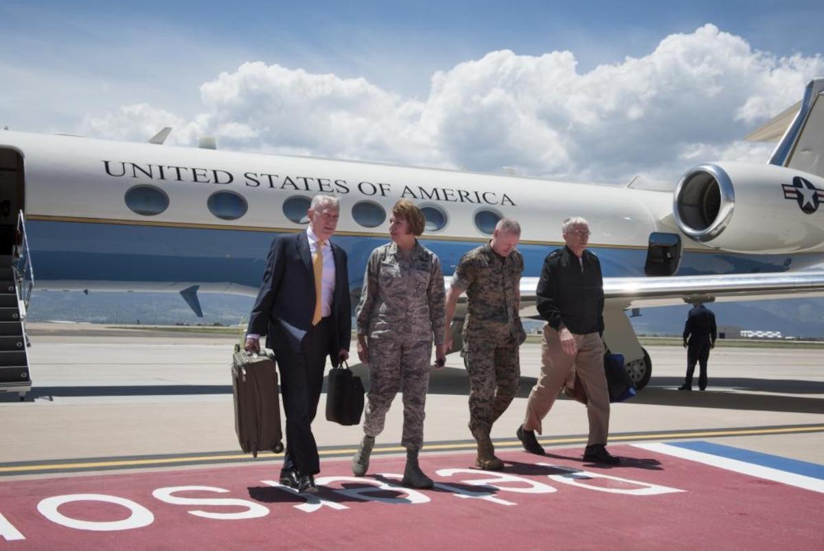 Defense Secretary James N. Mattis walks with Air Force Gen. Lori Robinson at Peterson Air Force Base in Colorado.