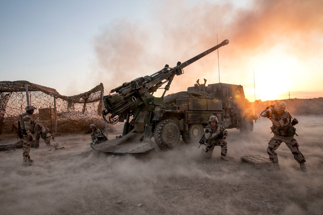 French soldiers, assigned to Task Force Wagram, fire a French Ceasar in support of Operation Roundup, in Al Qa'im, Iraq, May 16, 2018. As a non-permanent force the Coalition aims to enable the Iraqi security forces to be self-sufficient. (U.S. Army photo by Spc. Zakia Gray)