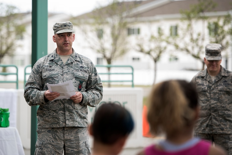 U.S. Air Force Col. Michael Staples, 673d Civil Engineer Group commander, reads the Arbor Day proclamation during an Arbor Day event at Ursa Major Elementary School at Joint Base Elmendorf-Richardson, Alaska, May 21, 2018. Ecologists and participants planted two trees at Ursa Major Elementary and the JBER Cache in celebration of Alaska's Arbor Day, May 17 and 21. National Arbor Day is always celebrated on the last Friday in April, however, Alaska's Arbor Day is celebrated on the third Monday in May. The Arbor Day Foundation recently named JBER a 2018 Tree City USA, an honor the base has earned for 21 years running.