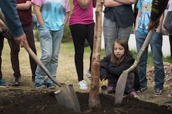 Alberto Cortez and Gerardo Medina, landscape specialists with Faltz Landscaping and Nursery, and Ursa Major Elementary School students shovel soil onto a spruce tree during an Arbor Day ceremony at Joint Base Elmendorf-Richardson, Alaska, May 21, 2018. Ecologists and participants planted two trees at Ursa Major Elementary and the JBER Cache in celebration of Alaska's Arbor Day, May 17 and 21. National Arbor Day is always celebrated on the last Friday in April, however, Alaska's Arbor Day is celebrated on the third Monday in May. The Arbor Day Foundation recently named JBER a 2018 Tree City USA, an honor the base has earned for 21 years running.