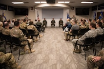 "Col. Devin R. Wooden, 137th Special Operations Wing commander (left), Col. Daniel R. ""Pinto"" Fowler, incoming 137th Special Operations Group commander (center), and Col. Kelly W. Cobble, outgoing 137th Special Operations Group commander (right), sit at the front of the room during the Group's change of command ceremony at Will Rogers Air National Guard Base in Oklahoma City, May 17, 2018. Fowler, formerly the Air National Guard's Advisor to U.S. Air Force Special Operations Command, Hurlbert Field, Fla., assumed command with more than 20 years of military experience, including three years as a Joint Terminal Attack Control qualified Air Liaison Officer and 12 years of flying. (U.S. Air National Guard photo by Staff Sgt. Kasey Phipps)"
