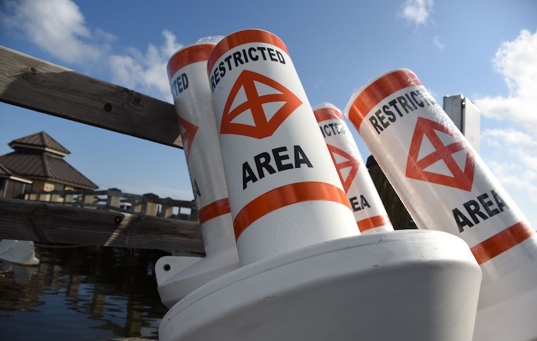 Restricted area buoys are placed on a pier at The Marina at Keesler Air Force Base, Mississippi, May 23, 2018. Keesler and the Department of Marine Resources partnered to install 15 buoys in the Biloxi Back Bay 150 feet from the Keesler shore line as an added base security measure. This project took almost two years of research and coordination with the 81st Security Forces Squadron Anti-terrorism Office, 81st Training Wing Legal Office, the state of Mississippi as well as the Army Corps of Engineers in Washington, D.C. (U.S. Air Force photo by Kemberly Groue)