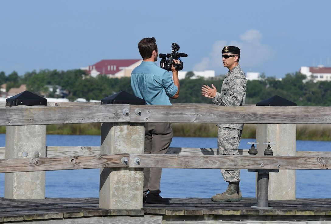 Jonathan Brannan, WLOX News reporter, interviews U.S Air Force Maj. Jonathon Murray, 81st Security Forces Squadron commander, at The Marina at Keesler Air Force Base, Mississippi, May 23, 2018. Keesler and the Department of Marine Resources partnered to install 15 restricted area buoys in the Biloxi Back Bay 150 feet from the Keesler shore line as an added base security measure. (U.S. Air Force photo by Kemberly Groue)