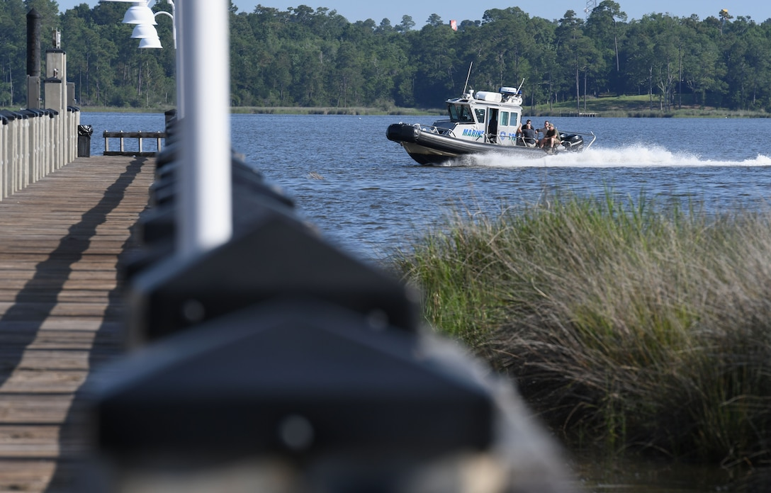 Members of the 81st Security Forces Squadron and the Department of Marine Resources drive through the Biloxi Back Bay to install 15 buoys 150 feet from the Keesler shore line as an added base security measure near Keesler Air Force Base, Mississippi, May 23, 2018. This project took almost two years of research and coordination with the 81st SFS Anti-terrorism Office, 81st Training Wing Legal Office, the state of Mississippi as well as the Army Corps of Engineers in Washington, D.C. (U.S. Air Force photo by Kemberly Groue)