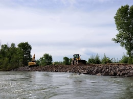 USACE contractors wrap up emergency repairs May 22, 2018, to stabilize an eroded section of the Heise-Roberts Levee near Lorenzo, Idaho.