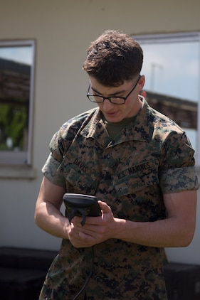 MCAS FUTENMA, OKINAWA, Japan – Lance Cpl. Elijah Davis looks at one of the monitors of a weather local substation May 15 aboard Marine Corps Air Station Futenma, Okinawa, Japan.