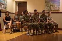 CAMP FOSTER, OKINAWA, Japan – New U.S. citizens sit during a naturalizing ceremony May 17 hosted at the Ocean Breeze aboard Camp Foster, Okinawa, Japan.