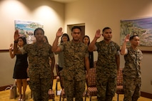 CAMP FOSTER, OKINAWA, Japan –New U.S. citizens recite the Oath of Allegiance during a nationalization ceremony May 17 hosted at the Ocean Breeze aboard Camp Foster, Okinawa, Japan.