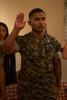 CAMP FOSTER, OKINAWA, Japan – Sgt. Nelson Sigrah recites the Oath of Allegiance during the naturalization ceremony May 17 hosted at the Ocean Breeze aboard Camp Foster, Okinawa, Japan.