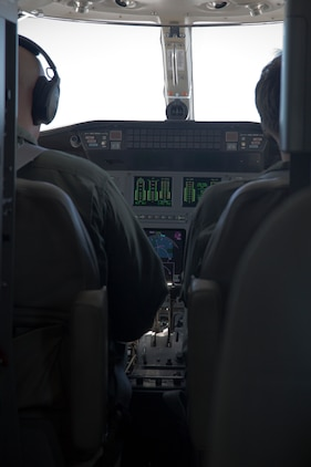 MCAS FUTENMA, OKINAWA, Japan – Pilots sit in the cockpit during a training flight from Marine Corps Air Station Futenma to Yokota Air Base May 22.