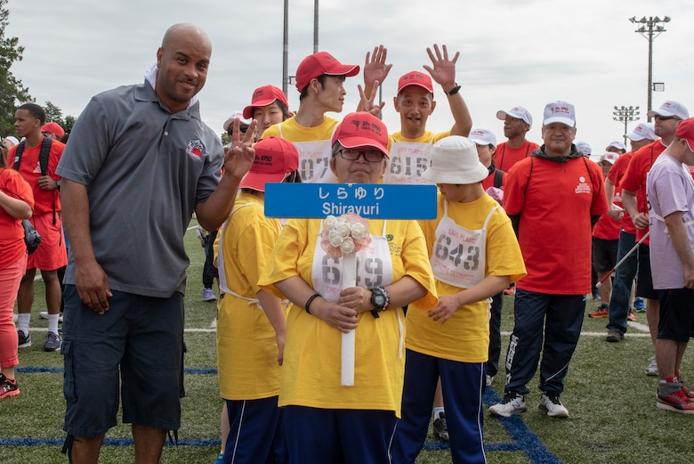 The athletes and coaches from Shirayuri pose for a photo immediately following the parade portion of the Kanto Plains Special Olympics at Yokota Air Base, Japan, May 19, 2018.