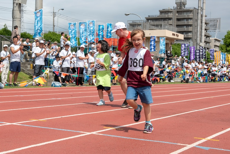 An athlete sprints to the finish line in the 50 meter race during the Kanto Plains Special Olympics at Yokota Air Base, Japan, May 19, 2018.
