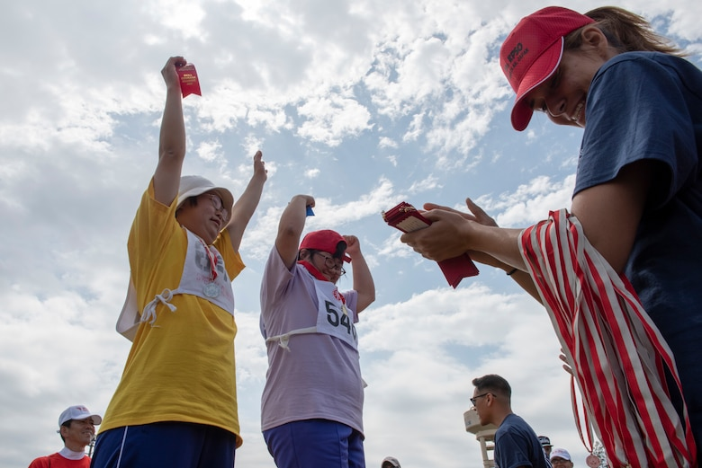 Athletes celebrate receiving their medals during the medal ceremony of the 50 meter sprint during the Kanto Plains Special Olympics at Yokota Air Base, Japan, May 19, 2018.