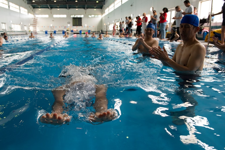 An athlete stretches out to grab the wall while competing in the 15 meter breaststroke race during the Kanto Plains Special Olympics at Yokota Air Base, Japan, May 19, 2018.