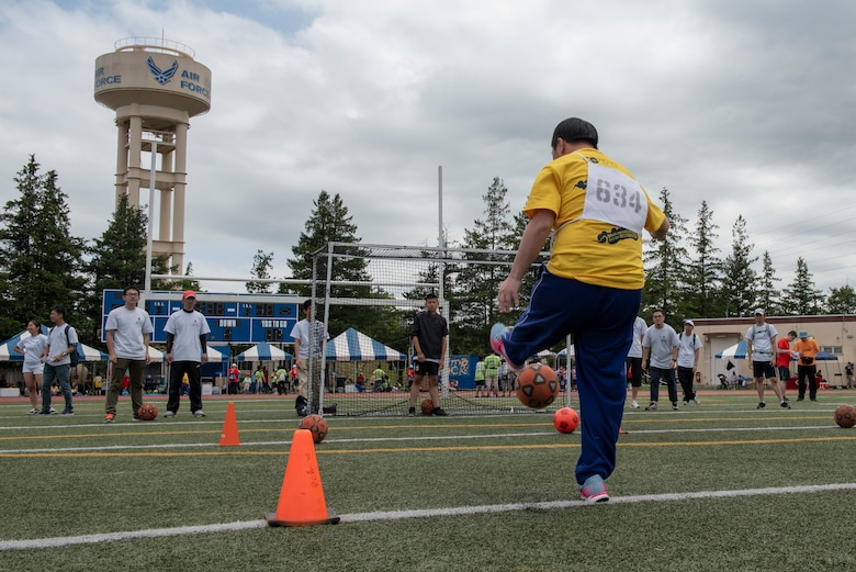 An athlete strikes the ball towards goal during the soccer shoot competition of the Kanto Plains Special Olympics at Yokota Air Base, Japan, May 19, 2018.