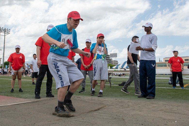 An athlete lands in the sand during the standing long jump competition of the Kanto Plains Special Olympics at Yokota Air Base, Japan, May 19, 2018.