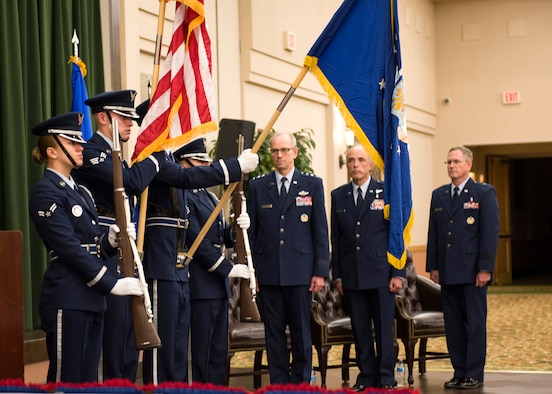 (From center to right) Lt. Gen. Mark A. Ediger, U.S. Air Force Surgeon General, Brig. Gen. (Dr.) Robert I. Miller, and Brig. Gen. James H. Dienst await the posting of the colors during the Air Force Medical Operations Agency (AFMOA) change of command at Joint Base San Antonio-Lackland, Texas, May 22, 2018. AFMOA oversees the execution of Air Force expeditionary capabilities and healthcare operations. Miller relinquished command of AFMOA to Dienst. (U.S. Air Force photo by Staff Sgt. Kevin Iinuma)
