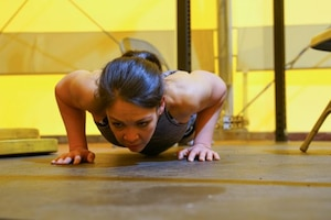 A woman does push ups.