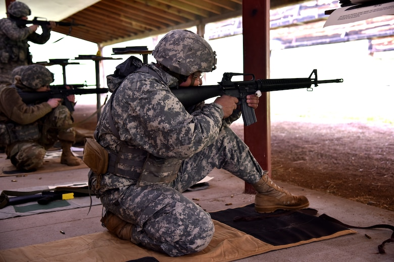 Specialist T.J. Carpenter, 139th Brigade Support Battalion religious affairs specialist, shoots an M-16 rifle from the kneeling position during The State Command Sergeant Major's Outdoor Match May 19, 2018 at Camp Rapid, S.D.
