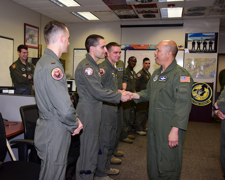 Lt. Gen. GI Tuck, 18th Air Force commander, speaks with student pilots in the 48th Flying Training Squadron May 17, 2018, on Columbus Air Force Base, Mississippi. Tuck went around Columbus AFB to see the pilot training mission before speaking at Specialized Undergraduate Pilot Training Class 18-09's graduation ceremony May 18. (U.S. Air Force photo by Elizabeth Owens)