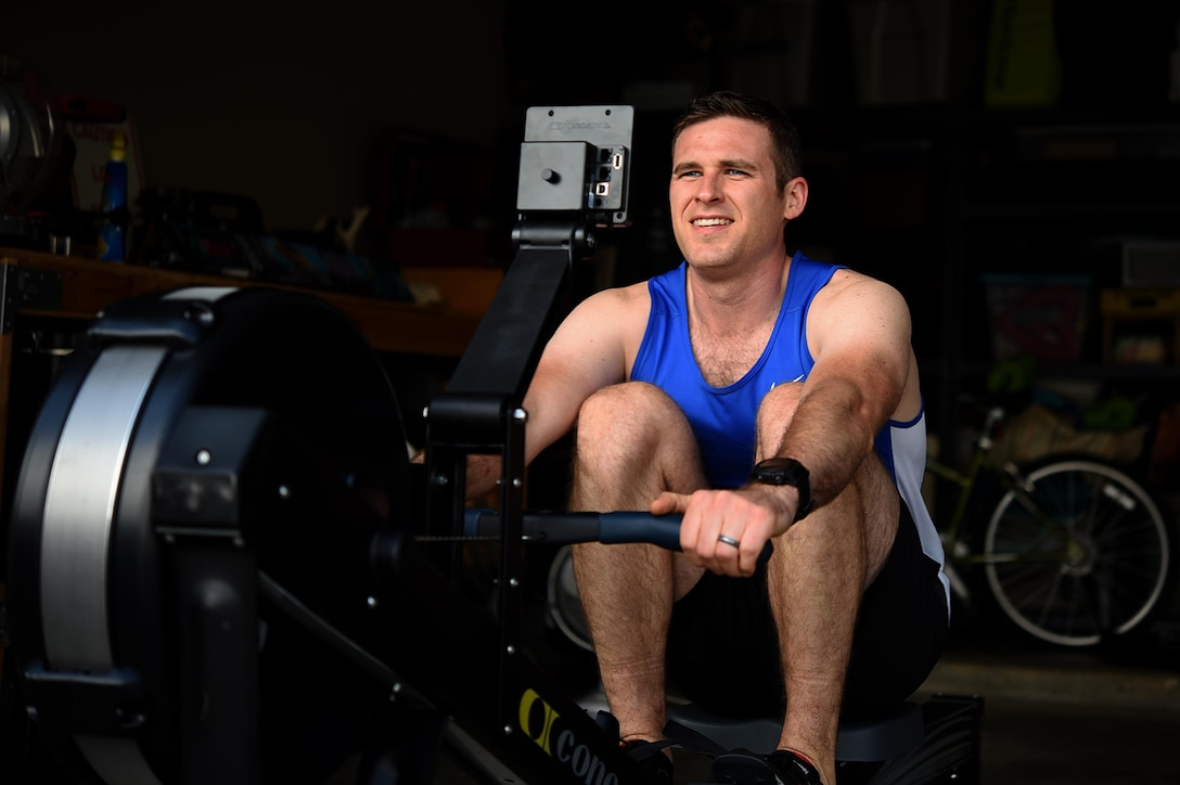 Capt. Hunter Barnhill, 37th Flying Training Squadron instructor pilot, completes a rep on his rowing machine May 15, 2018, on Columbus Air Force Base, Mississippi. Barnhill was diagnosed with brain cancer in 2017, and has since become one of the many resilient Airmen and participants in the Air Force Wounded Warrior community. (U.S. Air Force photo by Airman 1st Class Keith Holcomb)