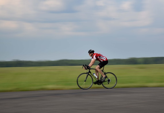 Capt. Hunter Barnhill, 37th Flying Training Squadron instructor pilot, trains on his road bike May 15, 2018, on Columbus Air Force Base, Mississippi. Barnhill will bike anywhere from a few miles to over 15 miles in one training session. As a member of the Air Force Wounded Warrior program he is preparing for the 2018 Warrior Games June 1-9 at the U.S. Air Force Academy in Colorado Springs, Colorado. (U.S. Air Force photo by Airman 1st Class Keith Holcomb)